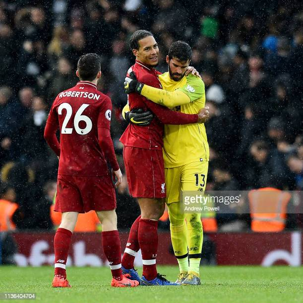 Virgil van Dijk and Alisson Becker of Liverpool embrace at the end of the Premier League match between Fulham FC and Liverpool FC at Craven Cottage...