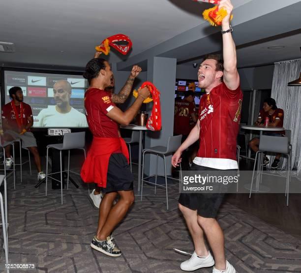 Virgil van Dijk and Andy Robertson of Liverpool celebrating winning the Premier League on June 25, 2020 in Liverpool, England.