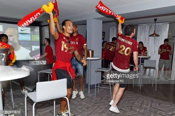 Virgil van Dijk and Andy Robertson of Liverpool celebrating winning the Premier League on June 25 2020 in Liverpool England