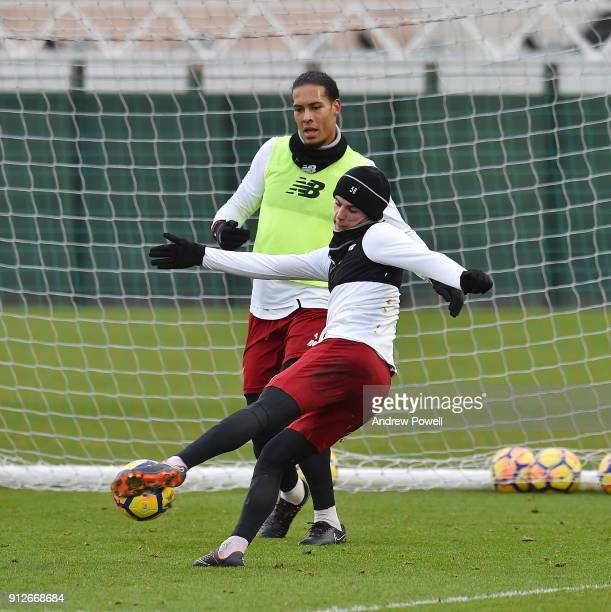 Virgil van Dijk and Ben Woodburn of Liverpool during a training session at Melwood Training Ground on January 31 2018 in Liverpool England