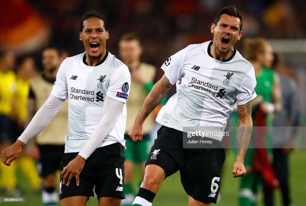 Virgil Van Dijk (L) and Dejan Lovren of Liverpool celebrate their semi final win at full time during the UEFA Champions League Semi Final Second Leg match between A.S. Roma and Liverpool at Stadio Olimpico on May 2, 2018 in Rome, Italy.