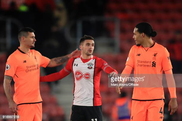 Virgil van Dijk and Dejan Lovren of Liverpool with Dusan Tadic of Southampton during the Premier League match between Southampton and Liverpool at St...