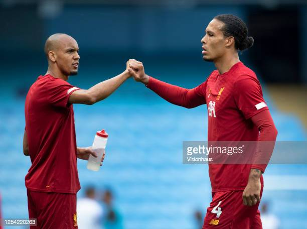 Virgil van Dijk and Fabinho of Liverpool during the warm up before the Premier League match between Manchester City and Liverpool FC at Etihad...