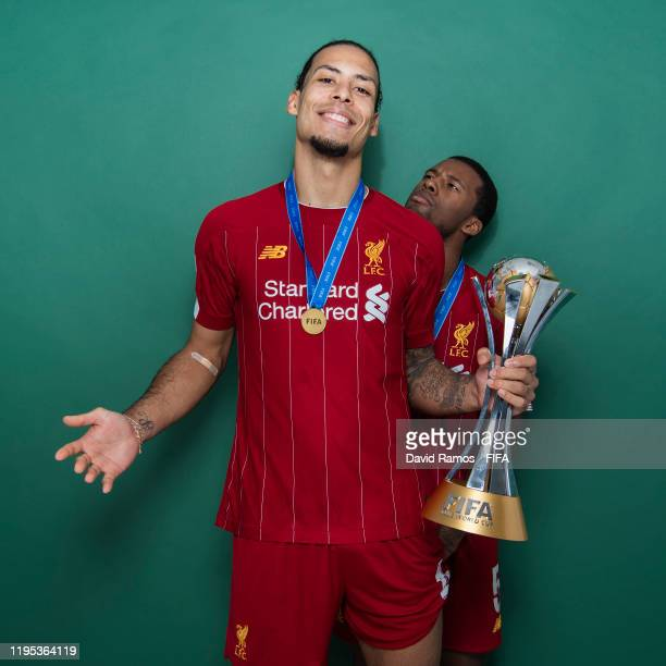 Virgil van Dijk and Georginio Wijnaldum of Liverpool pose with the Club World Cup trophy after the FIFA Club World Cup Qatar 2019 Final match between...