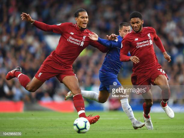 Virgil van Dijk and Joe Gomez of Liverpool combine to block out Eden Hazard of Chelsea during the Premier League match between Chelsea FC and...