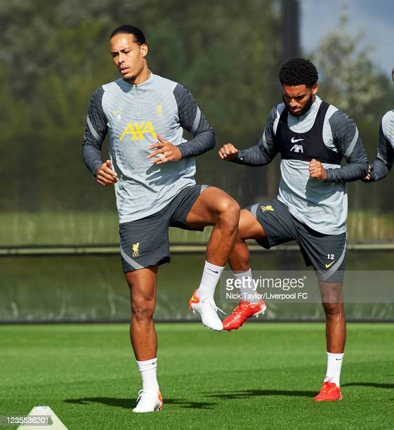 Virgil Van Dijk and Joe Gomez of Liverpool during a training session at AXA Training Centre on September 27, 2021 in Kirkby, England.