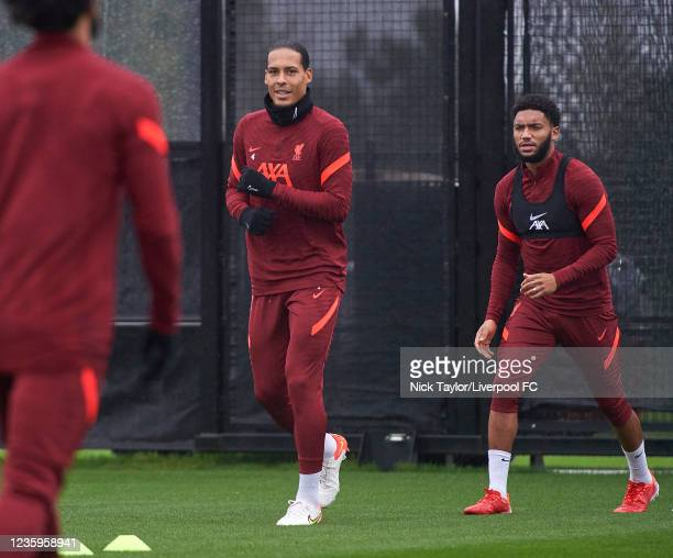 Virgil Van Dijk and Joe Gomez of Liverpool during a training session at AXA Training Centre on October 18, 2021 in Kirkby, England.