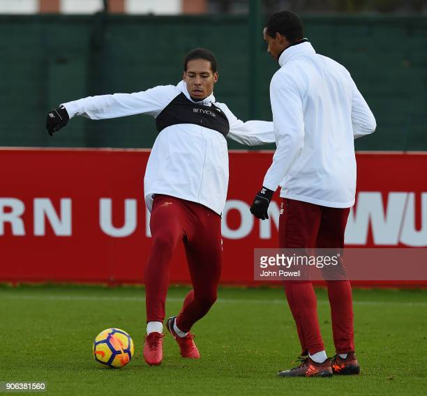Virgil van Dijk and Joel Matip of Liverpool during a training session at Melwood Training Ground on January 18 2018 in Liverpool England