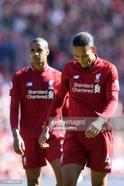 Virgil van Dijk and Joel Matip of Liverpool look dejected during the Premier League match between Liverpool FC and Wolverhampton Wanderers at Anfield...