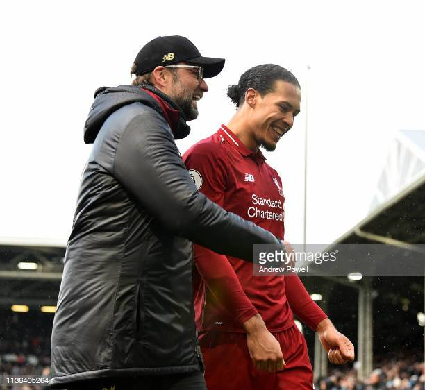 Virgil van Dijk and Jurgen Klopp manager of Liverpool embrace at the end of the Premier League match between Fulham FC and Liverpool FC at Craven...