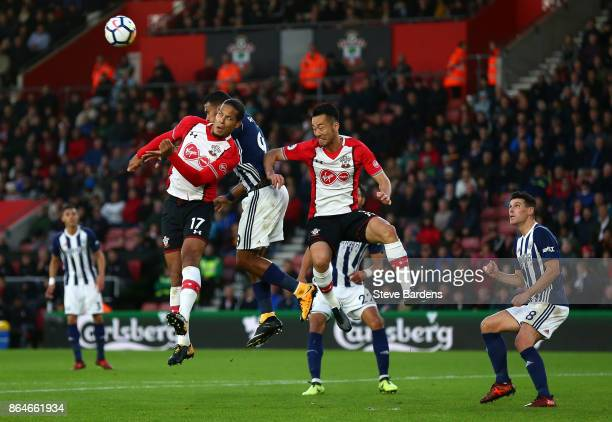 Virgil van Dijk and Maya Yoshida of Southampton clash with Jose Salomon Rondon of West Bromwich Albion during the Premier League match between...
