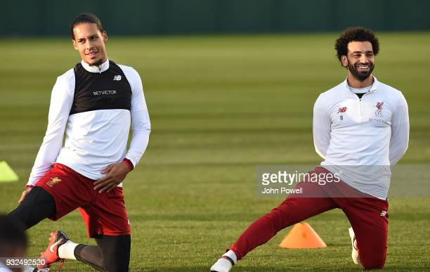 Virgil van Dijk and Mohamed Salah of Liverpool during the training session at Melwood Training Ground on March 15 2018 in Liverpool England