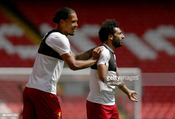 Virgil van Dijk and Mohamed Salah of Liverpool react during a training session at Anfield on May 21 2018 in Liverpool England