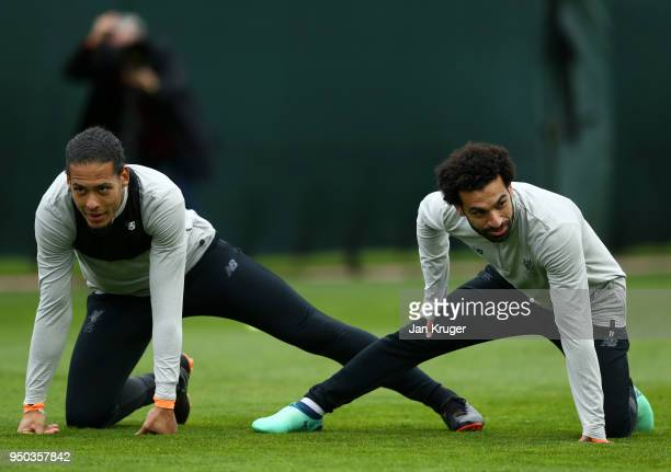 Virgil van Dijk and Mohamed Salah of Liverpool warm up during a training session on April 23 2018 in Liverpool England