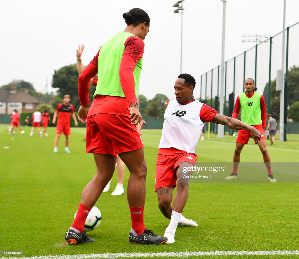 Virgil van Dijk and Nathaniel Clyne of Liverpool during a training session at Melwood Training Ground on July 12, 2018 in Liverpool, England.