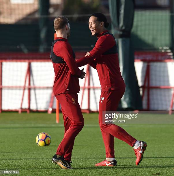 Virgil van Dijk and Ragnar Klavan of Liverpool during a training session at Melwood Training Ground on January 10 2018 in Liverpool England