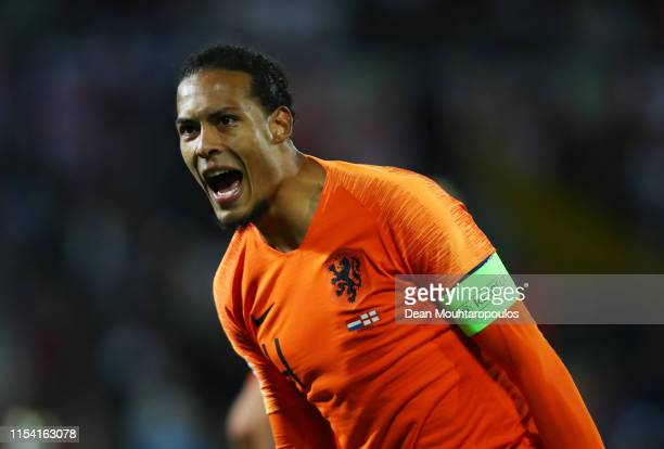 Virgil van Dijk celebrates as Quincy Promes of the Netherlands scores his team's third goal during the UEFA Nations League SemiFinal match between...