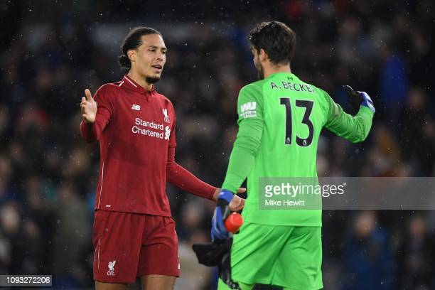 Virgil van Dijk celebrates with team mate Alisson Becker of Liverpool at the end of the Premier League match between Brighton Hove Albion and...
