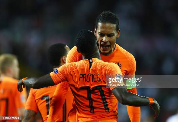 Virgil van Dijk congratulates Quincy Promes of the Netherlands as he celebrates after scoring his team's third goal during the UEFA Nations League...