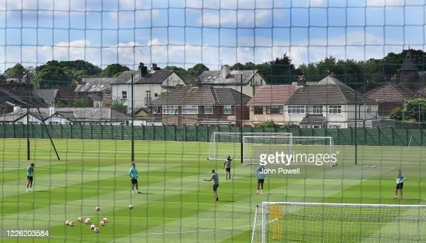 Virgil van Dijk James Milner Dejan Lovren and Trent AlexanderArnold of Liverpool during a training session at Melwood Training Ground on May 21 2020...