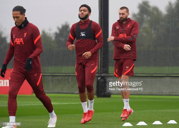 Virgil Van Dijk, Joe Gomez and Nathaniel Phillips of Liverpool during a training session at AXA Training Centre on October 18, 2021 in Kirkby,...