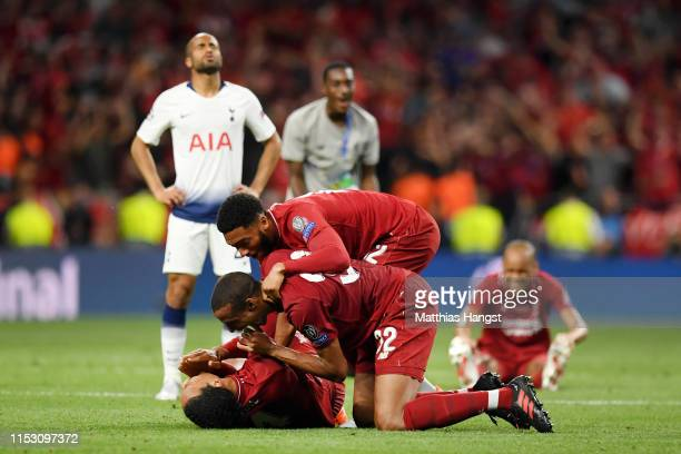 Virgil van Dijk, Joel Matip and Joe Gomez of Liverpool celebrate victory at full-time after the UEFA Champions League Final between Tottenham Hotspur...