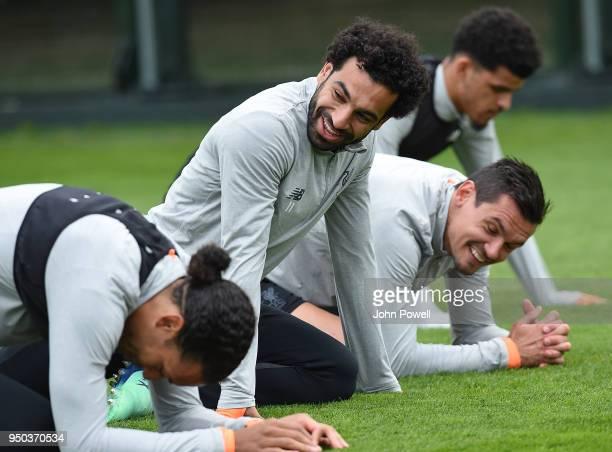 Virgil van Dijk Mohamed Salah and Dejan Lovren of Liverpool during a training session at Melwood Training Ground on April 23 2018 in Liverpool England