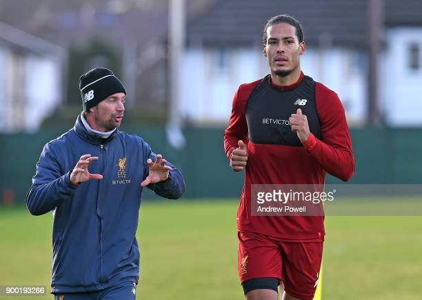 Virgil van Dijk new signing of Liverpool with Andreas Kornmayer head of fitness and conditioning at Melwood Training Ground on December 31 2017 in...