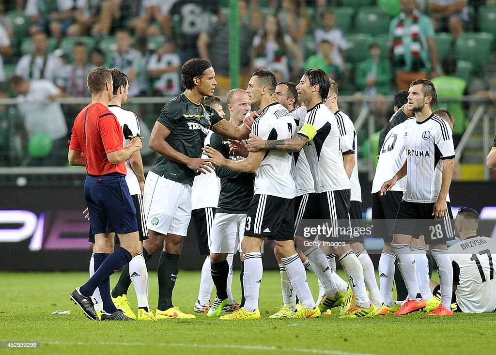 Virgil Van Dijk of Celtic discuses with Tomasz Jodlowiec of Legia during the third qualifying round UEFA Champions League match between Legia and Celtic at Pepsi Arena on July 30, 2014 in Warsaw, Poland.