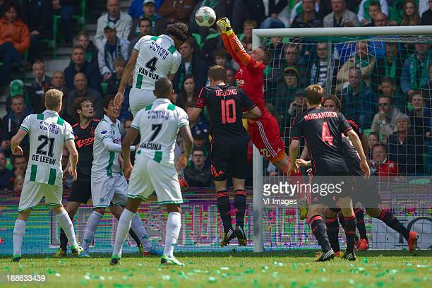 Virgil van Dijk of FC Groningen goalkeeper Jasper Cillessen of Ajax during the Dutch Eredivisie match between FC Groningen and Ajax on May 12 2013 at...