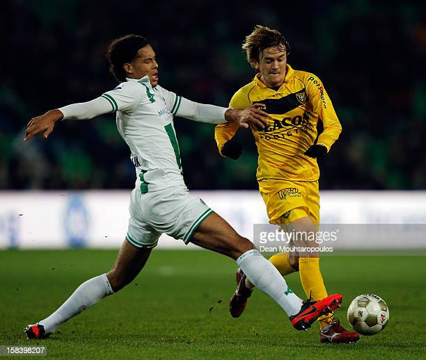 Virgil van Dijk of Groningen and Robert Cullen of Venlo battle for the ball during the Eredivisie match between FC Groningen and VVV Venlo at the...
