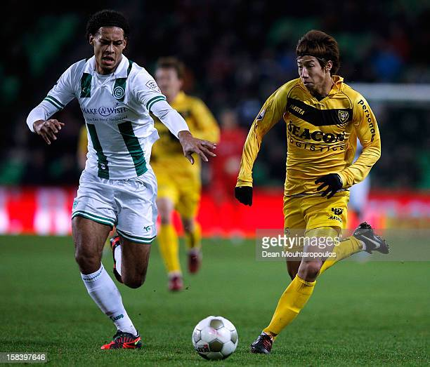 Virgil van Dijk of Groningen and Yuki Otsu of Venlo battle for the ball during the Eredivisie match between FC Groningen and VVV Venlo at the...