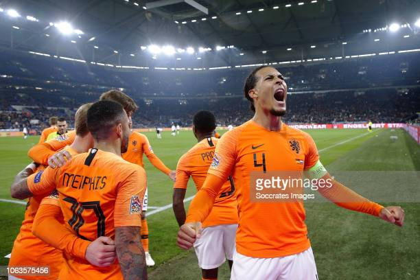 Virgil van Dijk of Holland celebrates 22 with Memphis Depay of Holland during the UEFA Nations league match between Germany v Holland at the Veltins...