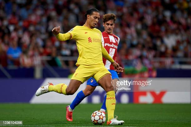 Virgil van Dijk of Liverpool and Antoine Griezmann of Atletico Madrid compete for the ball during the UEFA Champions League group B match between...
