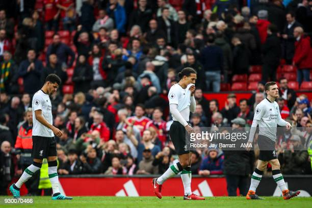 Virgil van Dijk of Liverpool and Dominic Solanke of Liverpool and Andrew Robertson of Liverpool walk off dejected at full time during the Premier...