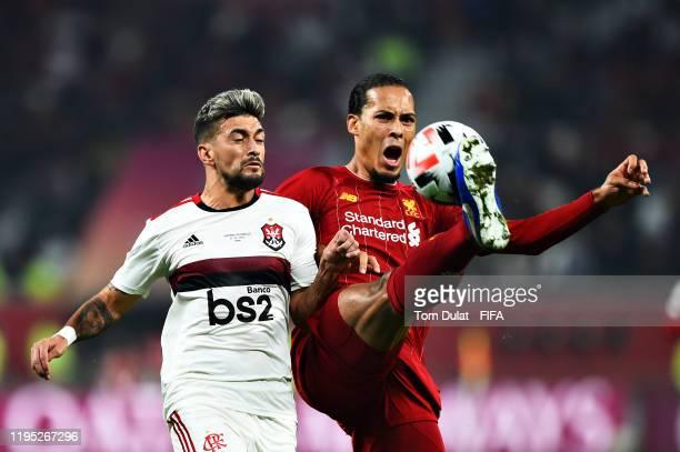 Virgil van Dijk of Liverpool and Giorgian De Arrascaeta of CR Flamengo battle for the ball during the FIFA Club World Cup 2019 final match between...