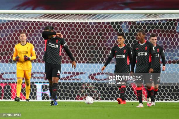 Virgil van Dijk of Liverpool and his teammates look dejected as their team concede a fourth goal during the Premier League match between Aston Villa...