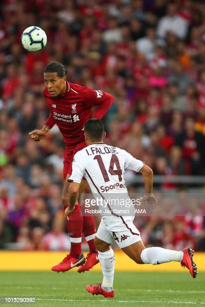 Virgil van Dijk of Liverpool and Iago Falque of Torino during the preseason friendly between Liverpool and Torino at Anfield on August 7 2018 in...