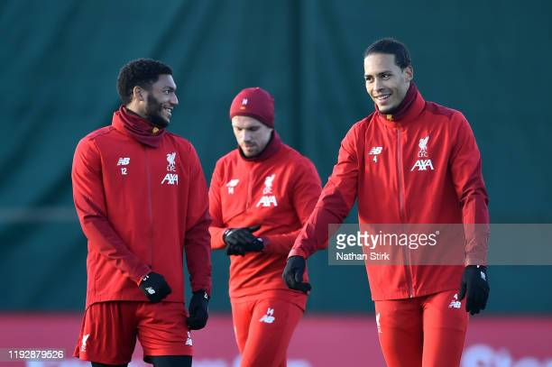 Virgil van Dijk of Liverpool and Joe Gomez of Liverpool speak during a training session ahead of their UEFA Champions League Group E match against RB...
