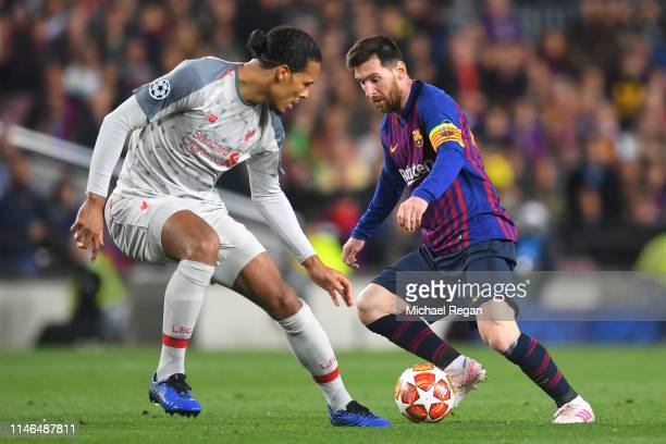 Virgil van Dijk of Liverpool and Lionel Messi of Barcelona in action during the UEFA Champions League Semi Final first leg match between Barcelona...