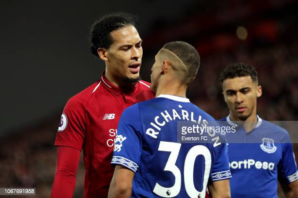 Virgil van Dijk of Liverpool and Richarlison of Everton react during the Premier League match between Liverpool FC and Everton FC at Anfield on...