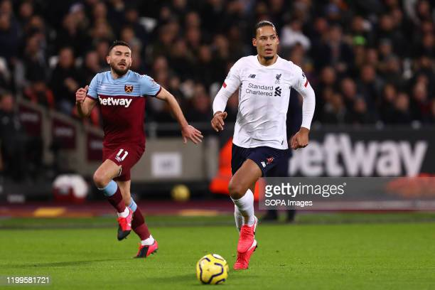 Virgil van Dijk of Liverpool and Robert Snodgrass of West Ham United in action during the Premier League match between West Ham United and Liverpool...