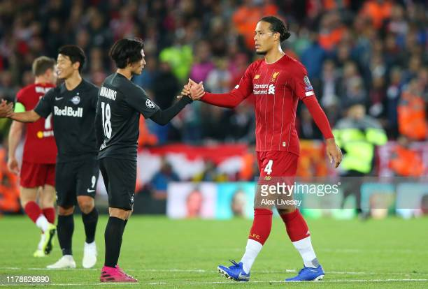 Virgil van Dijk of Liverpool and Takumi Minamino of Red Bull Salzburg shake hands during the UEFA Champions League group E match between Liverpool FC...