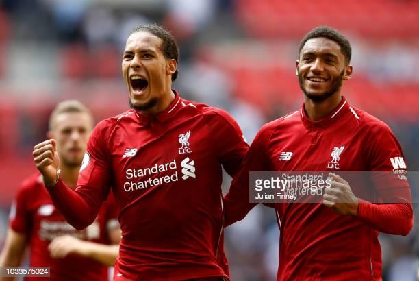 Virgil van Dijk of Liverpool and team mate Joe Gomez celebrate following the Premier League match between Tottenham Hotspur and Liverpool FC at...