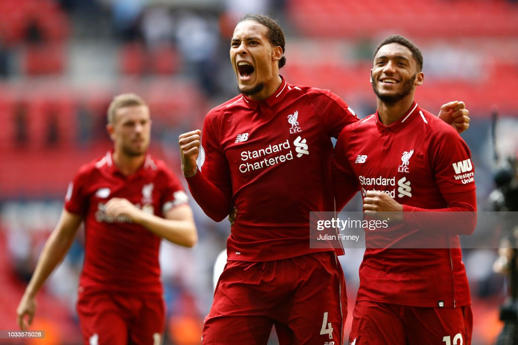 Virgil van Dijk of Liverpool and team mate Joe Gomez celebrate following the Premier League match between Tottenham Hotspur and Liverpool FC at Wembley Stadium on September 15, 2018 in London, United Kingdom.