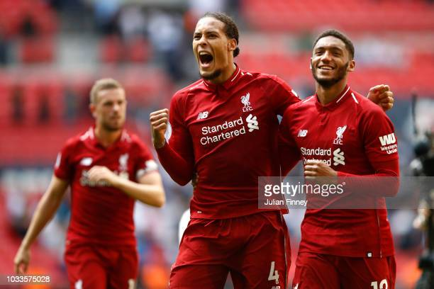 Virgil van Dijk of Liverpool and team mate Joe Gomez celebrate following the Premier League match between Tottenham Hotspur and Liverpool FC at...