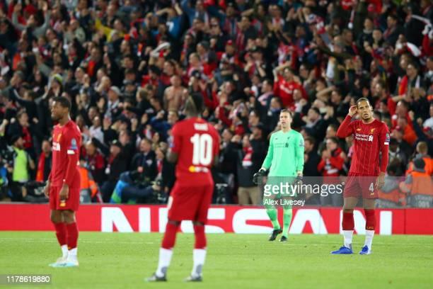 Virgil van Dijk of Liverpool and team mates react after Salzburg score their third goal during the UEFA Champions League group E match between...