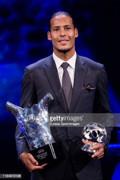 Virgil Van Dijk of Liverpool and the Netherlands poses with the 2018/19 UEFA Player's of the Year Trophy and best defender during the KickOff...
