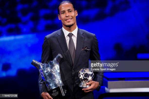 Virgil Van Dijk of Liverpool and the Netherlands poses with the 2018/19 UEFA Player's of the Year Trophy and best defender during the Kick-Off...