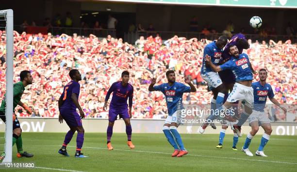 Virgil van Dijk of Liverpool attempts a header during the international friendly game between Liverpool and Napoli at Aviva Stadium on August 4 2018...